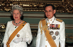 File photo dated 28/10/96 of Queen Elizabeth II and King Bhumibol Adulyadej of Thailand at a state banquet at the Chakri Palace in Bangkok, as the Queen has become the world's longest reigning living monarch following his death.