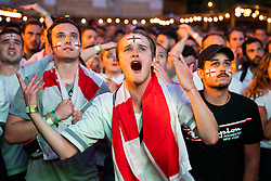 © Licensed to London News Pictures. 11/07/2018. London, UK. England fans in Flat Iron Square react in the final moments of the game as England lose to Croatia in the World Cup semi-final. Photo credit: Rob Pinney/LNP