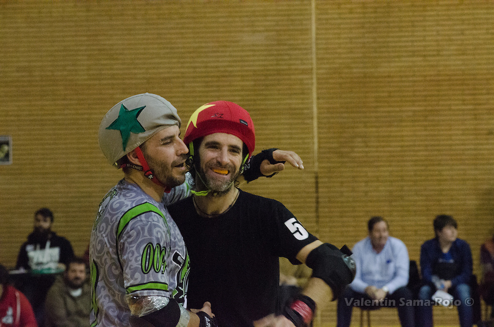 MADRID, SPAIN - January 23, 2016: Jammer of RockNRollaz (R), 56 Pere Ballari, and jammer of MadRiders (L), 009 Ra, cheering eachother during the match held in Madrid.