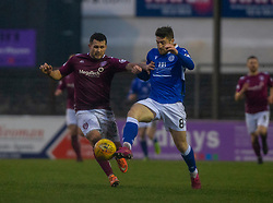 Arbroath's Davvid Hilson and Queen of the South's Lewis Kidd. Arbroath 2 v 0 Queen of the South, Scottish Championship game played 15/2/2020 at Arbroath's home ground, Gayfield Park.
