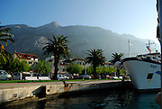 Makarska harbour and waterfront, with Biokovo National Park, part of the Dinaric Alps, in background. Makarska, Croatia