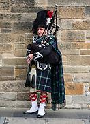Bagpiper in Highland dress, including kilt (or trews), tartan (plaid in North America), and sporran. Edinburgh, capital of Scotland, UK, Europe.