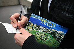 Manfreda writes postcard at Slovenian National team packing and going from Citadel Hotel to the Halifax airport, when they finished with games at IIHF WC 2008 in Halifax, on May 11, 2008, Canada. (Photo by Vid Ponikvar / Sportal Images)