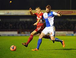 Bristol Rovers' Matt Harrold battles with a Crawley defender - Photo mandatory by-line: Seb Daly/JMP - Tel: Mobile: 07966 386802 08/01/2014 - SPORT - FOOTBALL - Broadfield Stadium - Crawley - Crawley Town v Bristol Rovers - FA Cup - Replay