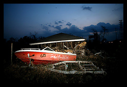 1 June, 2006. Lower 9th Ward, New Orleans, Louisiana. The sun sets on the first day of hurricane season. Piles of wreckage in the devastated Lower 9th Ward. Nine months after hurricane Katrina and the area continues to resemble a war zone.
