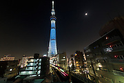 """Tokyo Skytree illuminated blue as part of the """"Turn the World UN Blue"""" campaign that marks the 70th anniversary of the formation of the United Nations. Tokyo, Japan. Saturday October 24th 2015. Over 200 iconic monuments , buildings, statues, bridges and other landmarks, in nearly 60 countries, will be lit up blue on United Nations Day (October 24th) as part of an exciting  new global campaign  to unite global citizens and promote a message of peace, development and human rights."""