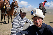 People watching a horseback wrestling competition at a traditional Kyrgyz horse games festival. Bosogo jailoo, Naryn province, Kyrgyzstan.