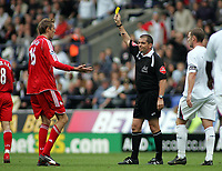 Photo: Paul Thomas.<br /> Bolton Wanderers v Liverpool. The Barclays Premiership. 30/09/2006.<br /> <br /> Peter Crouch (L) of Liverpool is shown a yellow card by Referee Mr P Dowd.