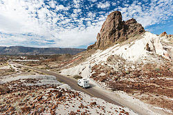 Streaking automobile on Ross Maxwell Scenic Drive near Cerro Castelon, Big Bend National Park, Texas, USA.