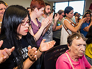 02 JULY 2019 - DES MOINES, IOWA: People applaud at the end of a protest in Rep. Cindy Axne's office. About 150 people came to Congresswoman Axne's office in Des Moines Tuesday to protest the treatment of migrant children detained by the US Border Patrol along the US/Mexico border. Axne was not in the office, but a member of Axne's staff took notes and promised to pass people's concerns on to the Congresswoman. Similar protests were held at other congressional offices and Immigration and Customs Enforcement (ICE) detention facilities across the country.          PHOTO BY JACK KURTZ