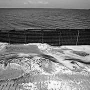 """Alabama National Guard soldiers (711 Bridge Support Battalion) installed barriers around a portion of Dauphin Island filled with a chemical compound that solidifies if oil seeps into the barrier..Ideally, the solidified material would then then be removed and disposed of safely. Beaches of Dauphin Island, Alabama, prepared in several ways for the growing oil spill in the Gulf of Mexico after the Deepwater Horizon disaster.  ltqmb """"Wall"""""""