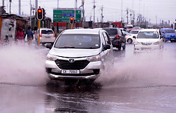 South Africa Cape Town 10 June 2020 Cars navigate their way through flooded Klipfontein road near Gugulethu, Western Cape in for three days of cold weather, heavy rain and gale force winds. Photographer Ayanda Ndamane African News Agency/ANA