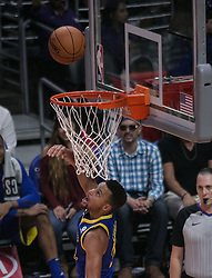 October 30, 2017 - Los Angeles, California, U.S - Stephen Curry #30 of the Golden State Warriors makes a reverse layup during their NBA game with the Los Angeles Clippers on Monday October 30, 2017 at the Staples Center in Los Angeles, California. Clippers v Warriors. Clippers lose to Warriors, 141-113. (Credit Image: © Prensa Internacional via ZUMA Wire)