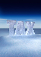 Tax letters made from ice in snowy winter landscape