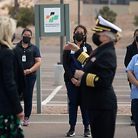 The First Lady of the United States Dr. Jill Biden stands with Dr. Sandi Adkins, Chief Executive Officer as they visit with essential workers at Tséhootsooí Medical Center in Fort Defiance, Arizona Friday.