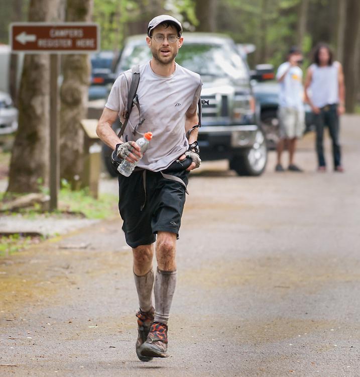 Brett Maune runs to the finish of the Barkley Marathons after 100 miles.