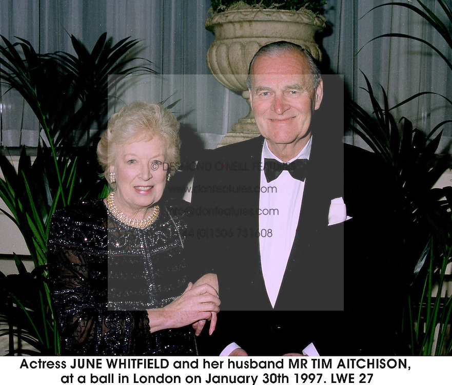 Actress JUNE WHITFIELD and her husband MR TIM AITCHISON, at a ball in London on January 30th 1997.LWE 27