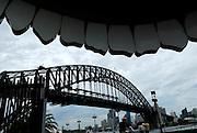 """Sydney Harbour Bridge viewed through the """"mouth"""" of the Luna Park entrance. Sydney, Australia"""