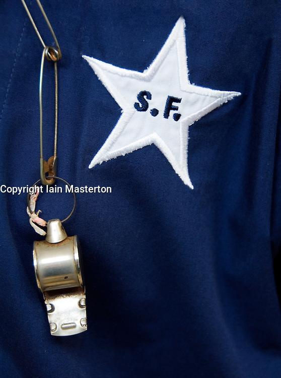 Detail of whistle and uniform of employee of the famous Star Ferry in Hong Kong