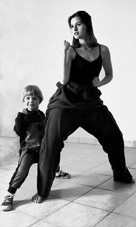 Portrait of mother and child working out together .