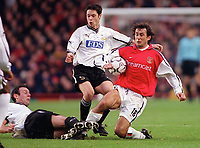 Gilles Grimandi (Arsenal) challenged by Malcolm Christie and Craig Burley (Derby). Arsenal 0:0 Derby County. F.A. Premiership, 11/11/2000. Credit: Colorsport / Stuart MacFarlane.