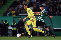 February 14, 2019 - Lisbon, Portugal - Villarreal's defender Ramiro Funes Mori vies with Sporting's midfielder Bruno Fernandes from Portugal during the UEFA Europa League Round of 32 First Leg football match Sporting CP vs Villarreal CF at Alvalade stadium in Lisbon, Portugal on February 14, 2019. (Credit Image: © Pedro Fiuza/ZUMA Wire)