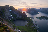 July midnight sun in the sky over Kirkejord from Reinebringen, Moskenesøy, Lofoten Islands, Norway