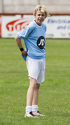 © Licensed to London News Pictures . 02/08/2015 . Droylsden Football Club , Manchester , UK . BRAYDEN FLETCHER ( Kelvin Fletcher's younger brother) on the subs bench . Celebrity football match in aid of Once Upon a Smile and Debra , featuring teams of soap stars . Photo credit : Joel Goodman/LNP