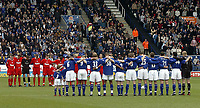 Photo. Glyn Thomas.<br /> Leicester City v Liverpool. FA Barclaycard Premiership.<br /> Walkers Stadium, Leicester. 28/03/2004.<br /> Players and fans observe a minute's silence for the Leicester City fan killed on the way to last week's fixture.