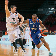 Anadolu Efes's Dontaye Draper (R) and Nizhny Novgorod's Taylor Rochestie (L) during their Turkish Airlines Euroleague Basketball Top 16 Round 11 match Anadolu Efes between Nizhny Novgorod at Abdi ipekci arena in Istanbul, Turkey, Thursday March 19, 2015. Photo by Aykut AKICI/TURKPIX