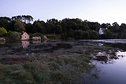 Dusk view along the tidal Goyen River on 24th September 2021 in Pont Croix, Brittany, France. Brittany is a peninsula, historical county, and cultural area in the west of France, covering the western part of what was known as Armorica during the period of Roman occupation. It became an independent kingdom and then a duchy before being united with the Kingdom of France in 1532 as a province governed as a separate nation under the crown.