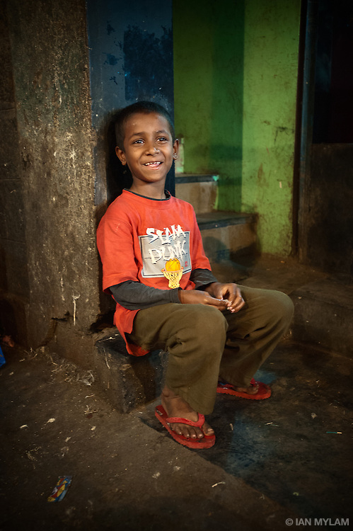 Boy on a Step at Dusk - Bangalore, India