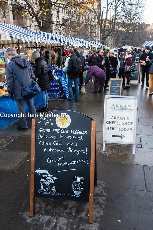 Weekend outdoor farmers's market held at foot of Edinburgh Castle in Edinburgh , Scotland, United Kingdom