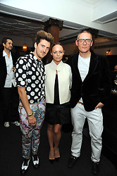 Left to right, HENRY HOLLAND, STELLA McCARTNEY and GILES DEACON at Vogue's Celebation of Fashion dinner held at The Albermarle, Brown's Hotel, Albermarle Street, London on 18th September 2008.
