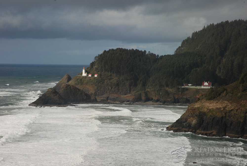 Heceta Head Light is a lighthouse located on the Oregon Coast 13 miles north of Florence, Oregon and 13 miles south of Yachats, Oregon, United States. It is located midway up a 205-foot (63 m) tall headland. Built in 1894, the 56-foot (17 m) tall lighthouse shines a beam visible for 21 miles, making it the strongest light on the Oregon Coast