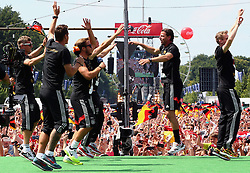 15.07.2014, Brandenburger Tor, Berlin, GER, FIFA WM, Empfang der Weltmeister in Deutschland, Finale, im Bild Die deutschen Spieler feiern ausgelassen am Brandenburger Tor. // during Celebration of Team Germany for Champion of the FIFA Worldcup Brazil 2014 at the Brandenburger Tor in Berlin, Germany on 2014/07/15. EXPA Pictures © 2014, PhotoCredit: EXPA/ Eibner-Pressefoto/ Pool<br /> <br /> *****ATTENTION - OUT of GER*****