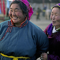 MONGOLIA, Darhad Valley. Batchuluun (42) (L) & Dolgorsoren (42) at a naadam festival in Rinchenlhumbe.