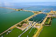 Nederland, Friesland, Kornwerderzand, 05-08-2014; Afsluitdijk met sluizencomplex, Waddenzee aan de horizon.<br /> Enclosure Dam near the Frisian coast. Sluices and locks. Left Waddenzee, IJsselmeer right.<br /> luchtfoto (toeslag op standaard tarieven);<br /> aerial photo (additional fee required);<br /> copyright foto/photo Siebe Swart.