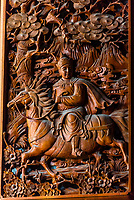 Ornate detailed carvings on massive teak doors, Chongsheng Temple, Dali, Yunnan Province, China. The temple dates from the 9th and 10th centuries.
