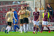 Sam Cosgrove (#16) of Aberdeen FC is congratulated by Ryan Hedges (#11) of Aberdeen FC after scoring his second goal from a penalty during the Betfred Scottish Football League Cup quarter final match between Heart of Midlothian FC and Aberdeen FC at Tynecastle Stadium, Edinburgh, Scotland on 25 September 2019.