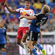 Tim Cahill, (left), New York Red Bulls, wins a header while challenged by Steven Lenhart, San Jose Earthquakes, during the New York Red Bulls Vs San Jose Earthquakes, Major League Soccer regular season match at Red Bull Arena, Harrison, New Jersey. USA. 19th July 2014. Photo Tim Clayton