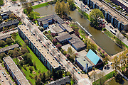 Nederland, Groningen, Groningen, 01-05-2013; De Wijert Noord. Rationele woonwijk uit de wederopbouwperiode. Karakteristieke afwisseling tussen (open) bebouwing en groene ruimtes. De verschillende soorten huizen herhalen zich (herhaalbare module van de wooneenheid ofwel stempels). Lichtblauwe puntdak van de Opstandingskerk. <br /> New residential area in Groningen built during the period of Reconstruction after World War II . Characteristic alternation between (open) built-up area and green spaces. Rationalistic architecture.<br /> luchtfoto (toeslag op standard tarieven)<br /> aerial photo (additional fee required)<br /> copyright foto/photo Siebe Swart