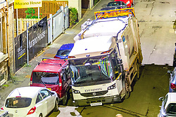 A council bin lorry opens up and falls into a sink hole on Murano Place, Edinburgh, shortly before 10pm