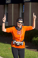 Goshen, New York - A womnan celebrates as she approaches the finish line of the Hambletonian Marathon fun run on Nov. 4, 2012. The run was put together for runners who had trained for the New York City Marathon, which was cancelled because of Hurricane Sandy.