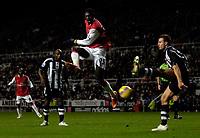 Photo: Jed Wee/Sportsbeat Images.<br /> Newcastle United v Arsenal. The FA Barclays Premiership. 05/12/2007.<br /> <br /> Arsenal's Emmanuel Adebayor (C) fires a shot at goal.