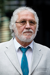 © Licensed to London News Pictures. 25/07/2014. London, UK. Veteran Radio One DJ, Dave Lee Travis arrives at Southwark Crown Court in London for a directions hearing on 25th July 2014. Photo credit : Vickie Flores/LNP