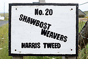 A roadside sign outside the home of a Harris Tweed weaver at the village of Shawbost, Isle of Lewis, Outer Hebrides, Scotland on 19 July 2018. Harris Tweed must be made from pure virgin wool which has been dyed and spun on the islands and handwoven at the home of the weaver in the Outer Hebrides of Scotland