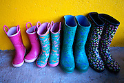colorful family boots rest on porch after rainy season, Costa Rica