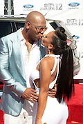 June 30, 2012-Los Angeles, CA : Recording Artist Flo Rida and Model/TV Personality Melyssa Ford attends the 2012 BET Awards held at the Shrine Auditorium on July 1, 2012 in Los Angeles. The BET Awards were established in 2001 by the Black Entertainment Television network to celebrate African Americans and other minorities in music, acting, sports, and other fields of entertainment over the past year. The awards are presented annually, and they are broadcast live on BET. (Photo by Terrence Jennings)