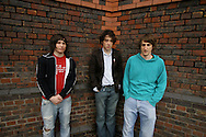 Matthew Murphy (centre), Dan Haggis (right) and Tord Øverland Knudsen of The Wombats, pictured in their native Liverpool. The band's debut album, A Guide to Love, Loss and Desperation, was released on 7th November 2007 and immediately entered the music charts. The band were tipped for further success in 2008.